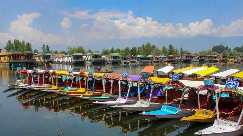 Empty shikaras parked at Dal Lake after government issued security advisory for Amarnath Yatris and tourists to curtail their stay in Kashmir. (PTI)