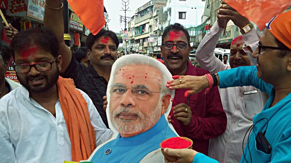 A BJP supporter celebrates the scrapping of Article 370 from Jammu and Kashmir, Varanasi, August 5, 2019