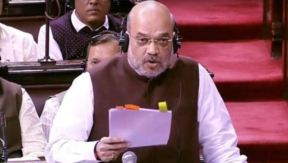 Home Minister Amit Shah addresses the Rajya Sabha in New Delhi on Monday.