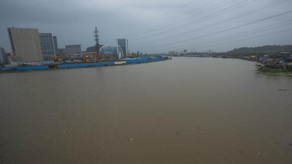 Mumbai, India - Aug. 4, 2019: Level of Mithi river increases due to heavy rain in Mumbai, India.