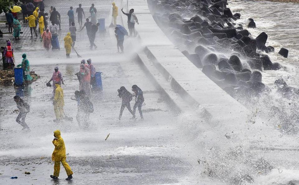 People enjoy the High Tide at Marine Drives in Mumbai, India, on Sunday, August 4, 2019. (Photo by Anshuman Poyrekar/Hindustan Times)