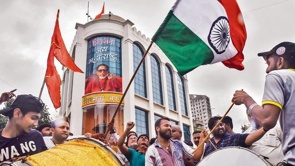 Shiv Sena activist celebrate the government revoking Kashmir's special status, outside Sena Bhavan, Dadar in Mumbai, on Monday.