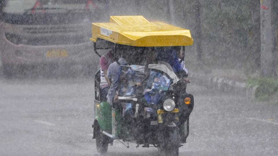 Commuters caught up in rain, Sector 27, in Noida, on Monday, August 5, 2019.