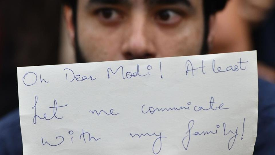 An activist takes part in a protest in Bangalore on August 5, 2019, in reaction to the Indian government scrapping Article 370 that granted a special status to Jammu and Kashmir.
