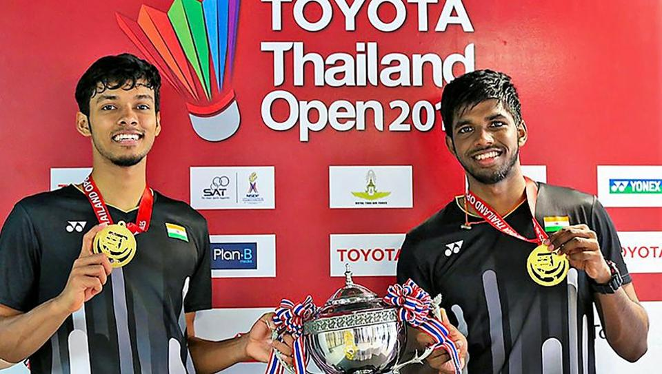 Satwiksairaj Rankireddy and Chirag Shetty pose with their medals and trophy after winning the Thailand Open 2019.