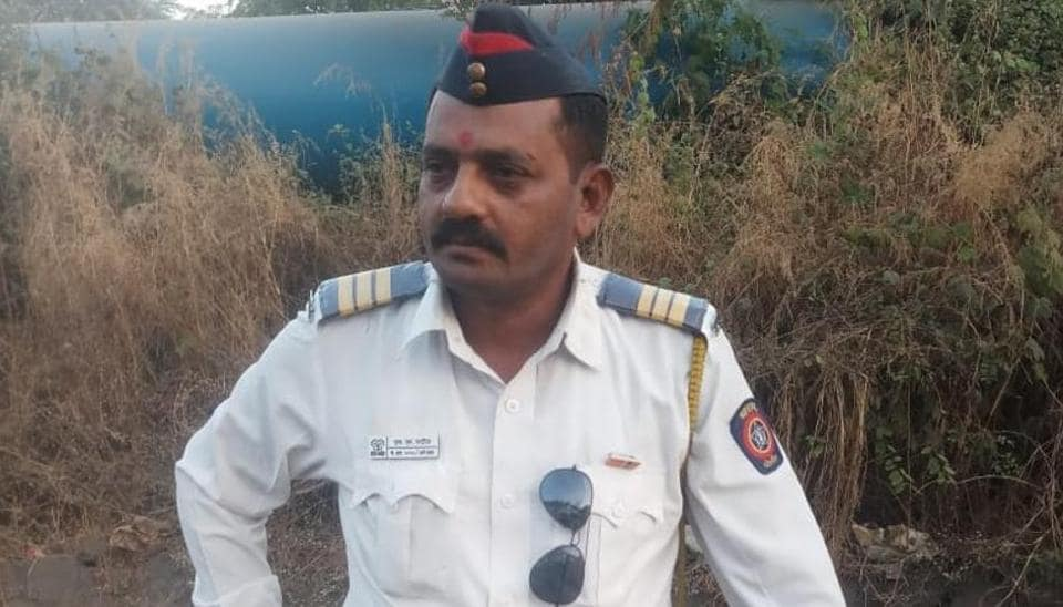 Sanjeev Patil (49), a traffic policeman in Ambernath on the outskirts of Mumbai was killed after a  truck knocked down his motorcycle on a potholed road Tuesday night.