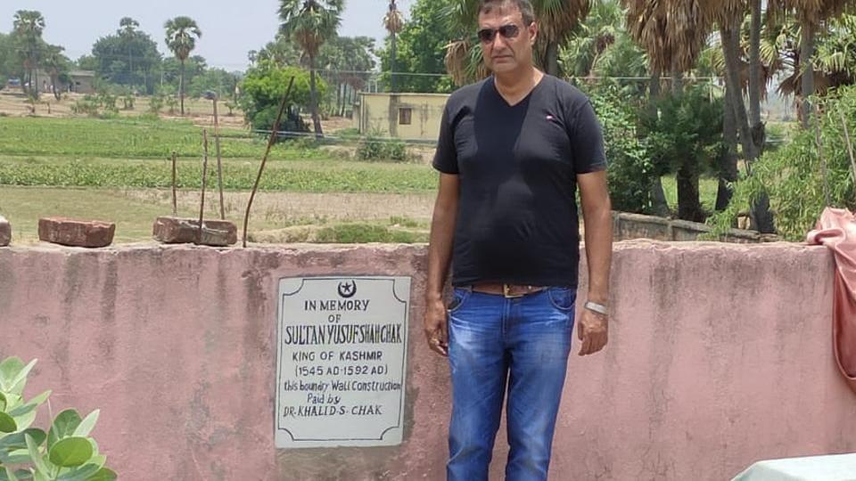 Yasir Iqbal, a descendant of Yusuf Shah Chak, at the tomb of Kashmir's last Muslim ruler's grave in Nalanda.