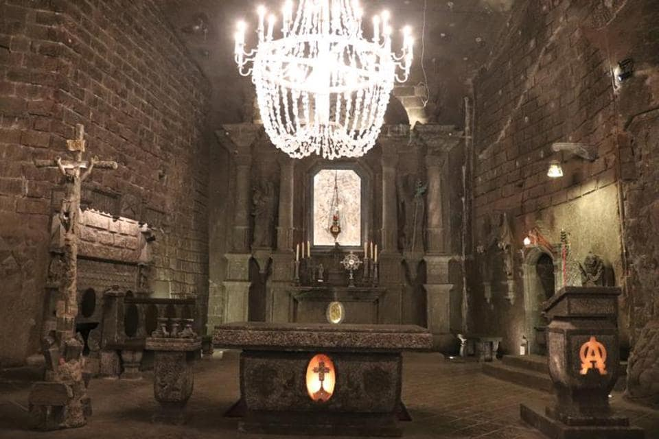 A large salt chandelier in the Chapel of St Kinga. All through the mine are chandeliers like this one — made up of one ring of candles, whose light is then reflected off the thousands of salt crystals in the other tiers.