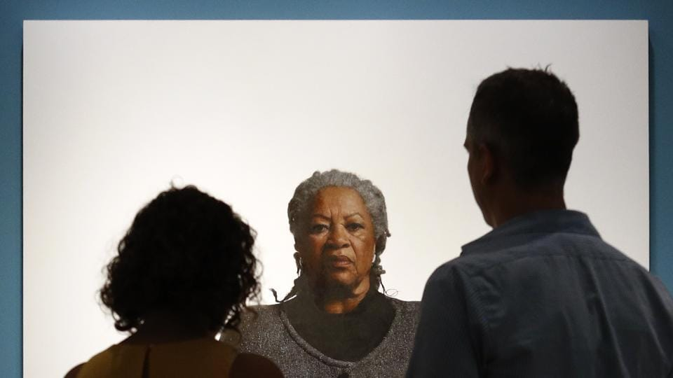 Visitors view a portrait of Toni Morrison, by the artist Robert McCurdy at the National Portrait Gallery in Washington. Morrison, a pioneer and giant of modern literature whose imaginative power in 'Beloved,' 'Song of Solomon' and other works transformed American letters by dramatizing the pursuit of freedom within the boundaries of race, died aged 88 following a brief illness. (Patrick Semansky / AP)