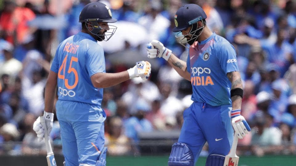 Rohit Sharma, left, bumps fist with Virat Kohli during the match against West Indies.
