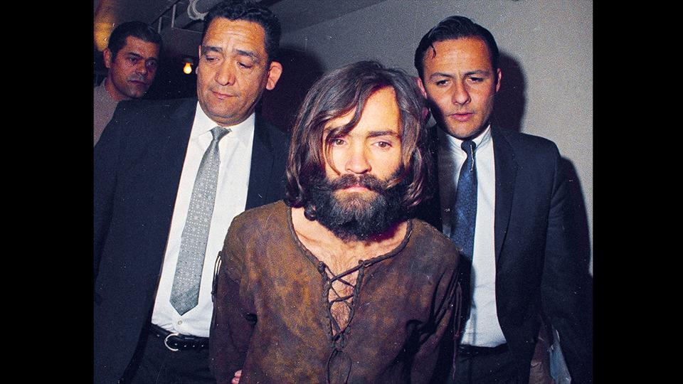 Charles Manson is escorted to his arraignment on conspiracy-murder charges in connection with the Sharon Tate murder case in Los Angeles. Fifty years ago--on successive nights in August 1969, the so-called Manson family murder, Charles Manson dispatched a group of disaffected young hippie followers on a two-night killing spree that terrorized Los Angeles and in the years since has come to represent the face of evil.  (AP File)