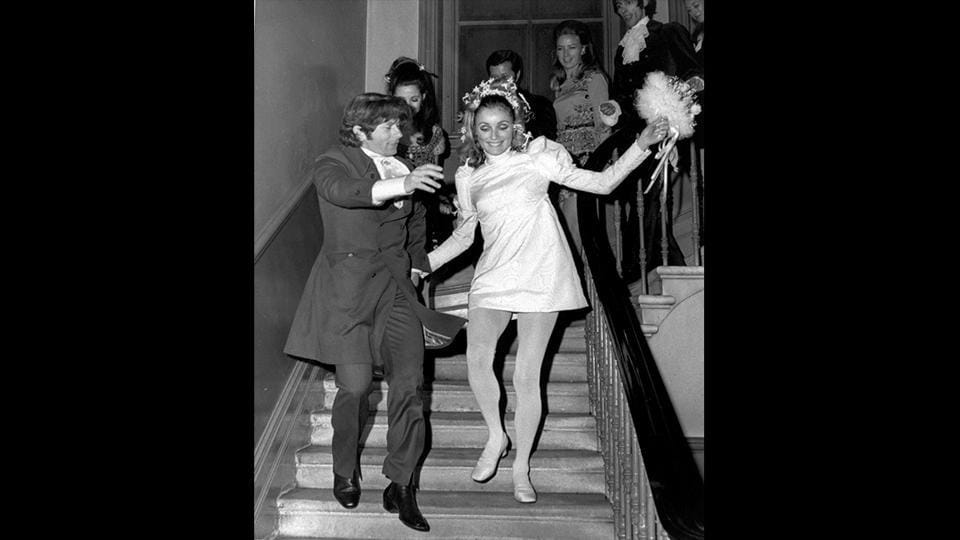 In this file photo, American actress Sharon Tate and Polish born film director Roman Polanski skip downstairs after their wedding at Chelsea Register Office in London, on January 20, 1968. As a tour guide specializing in notorious Hollywood deaths, Scott Michaels is well aware of America's morbid fascination with the dark side of Tinseltown. (Eddie Worth / AP File)