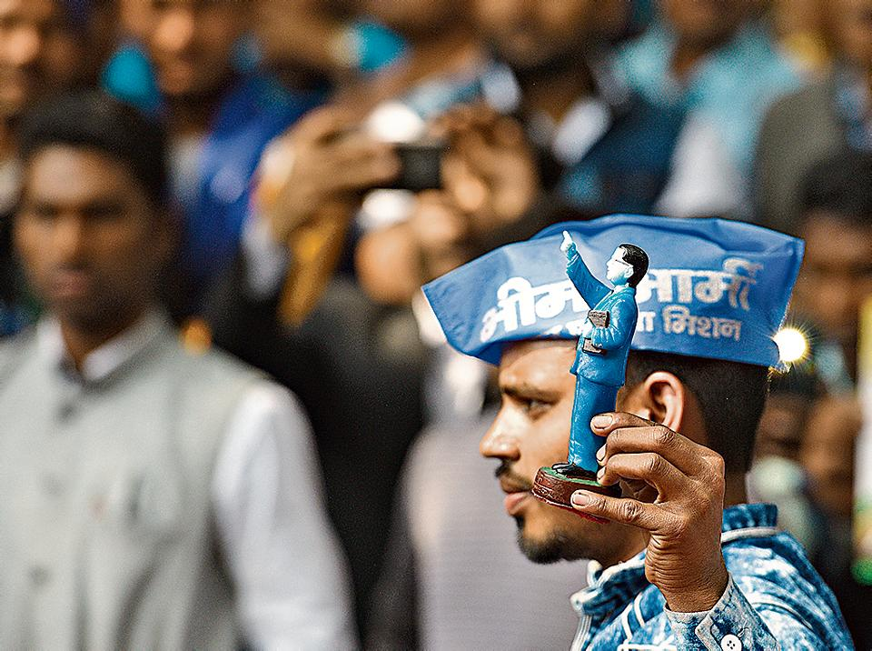 A Bhim Army supporter holds up an Ambedkar figure at a rally celebrating political leader Kanshi Ram's 85th birthday on March 15, 2019.