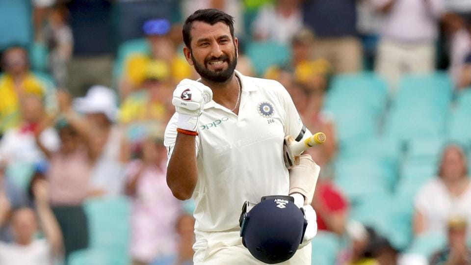 India's Cheteshwar Pujara celebrates his century (100 runs) during the first day of the fourth and final cricket Test against Australia at the Sydney Cricket Ground in Sydney.