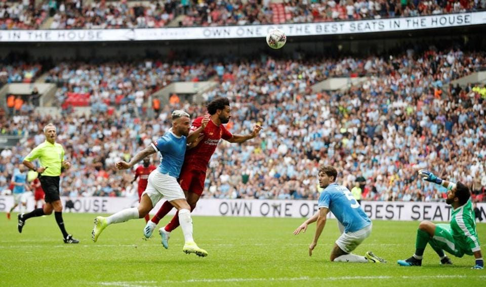 Soccer Football - FA Community Shield - Manchester City v Liverpool - Wembley Stadium, London, Britain - August 4, 2019 Liverpool's Mohamed Salah heads at goal Action Images via Reuters/Matthew Childs