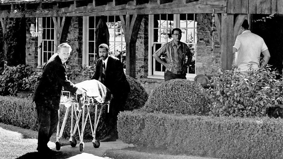 "The body of actress Sharon Tate is taken from her rented house on Cielo Drive in the Bel-Air area of Los Angeles, on August 09, 1969. Michaels drives his customers up to Cielo Drive, the leafy and winding road above exclusive Beverly Hills. One of those customers last year was director Quentin Tarantino, undertaking research for his new hit movie ""Once Upon a Time in Hollywood"" which takes the killings as its backdrop. (AP File)"