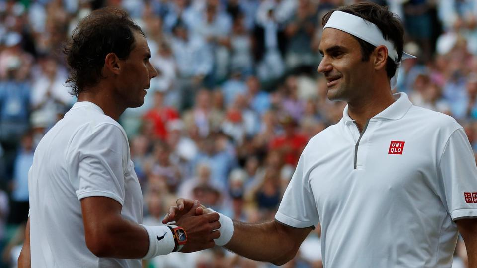 Switzerland's Roger Federer (R) shakes hands and embraces Spain's Rafael Nadal (L).