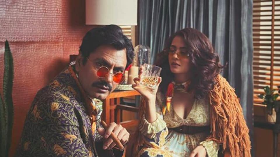 Actors Nawazuddin Siddiqui and Surveen Chawla pose for Sacred Games season 2.