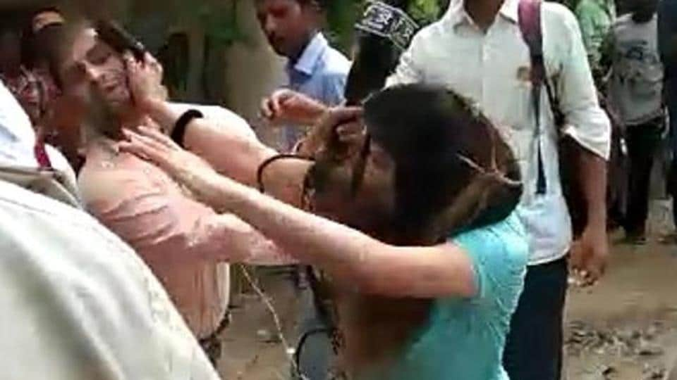 The woman, spotting a journalist making a video of the incident, snatched his camera and started assaulting him.