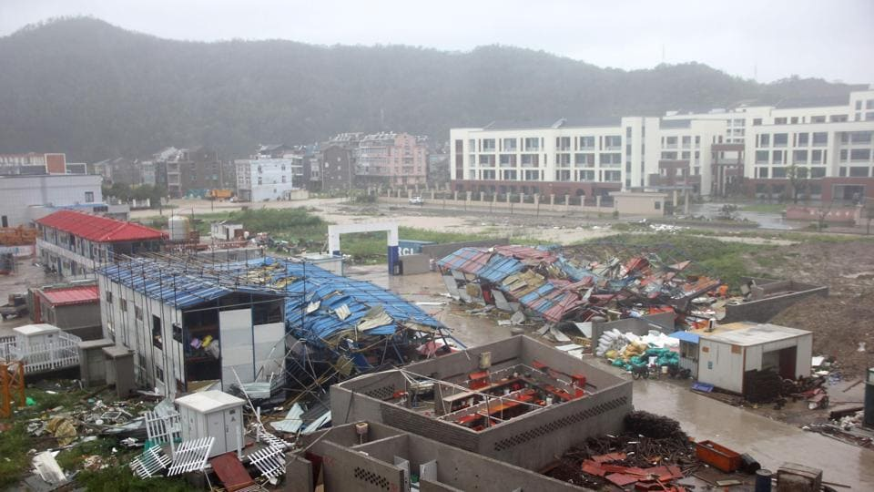 Damaged worker accommodation buildings are seen at a construction site in Wenling City, in China's eastern Zhejiang province after being hit by Typhoon Lekima today. At least 18 people were killed and 14 others missing as Typhoon Lekima lashed eastern China, downing thousands of trees and forcing more than a million people from their homes. (AFP / China OUT)