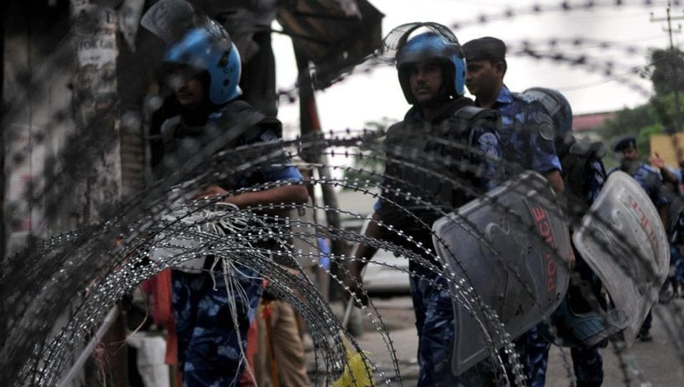 Rapid Action Force (RAF) personnel patrol a street during restrictions, in Jammu, India, on Friday, Aug 9, 2019.