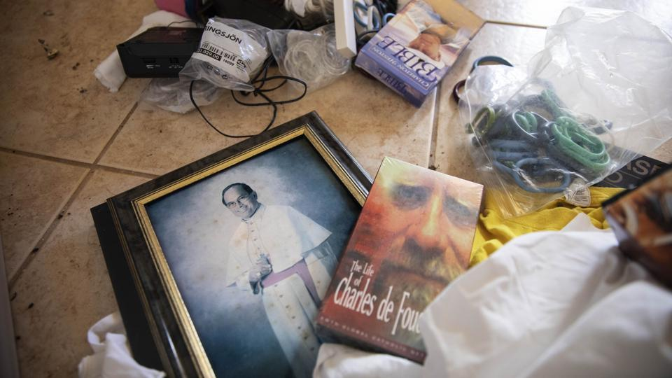 A photo of former Archbishop Anthony Apuron lays among discarded items on the floor of the former Accion Hotel which was a seminary but is now vacant and for sale by the Catholic Church, in Yona, Guam. In April the Vatican revealed that Pope Francis had upheld the findings of a secret church trial that found Apuron guilty of sex crimes against children. Anthony Apuron denies the allegations, which are detailed in lawsuits. (David Goldman / AP)
