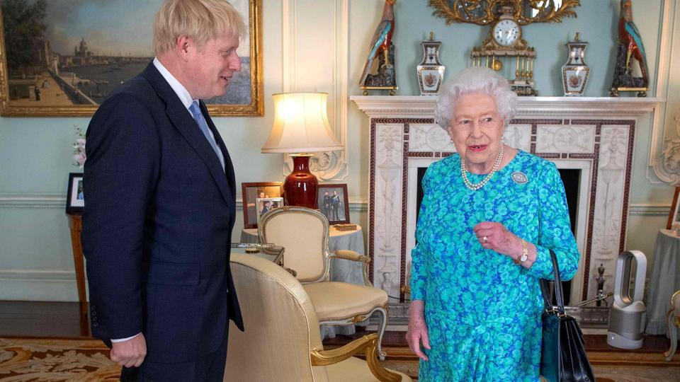 Britain's Queen Elizabeth II welcomes newly elected leader of the Conservative party, Boris Johnson during an audience in Buckingham Palace, London on July 24, 2019, where she invited him to become Prime Minister and form a new government.