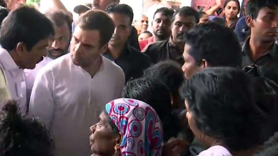 Kerala, Aug 11 (ANI): Congress leader Rahul Gandhi and KC Venugopal talk to flood-affected people at a relief camp in Wayanad on Sunday. (ANI Photo)