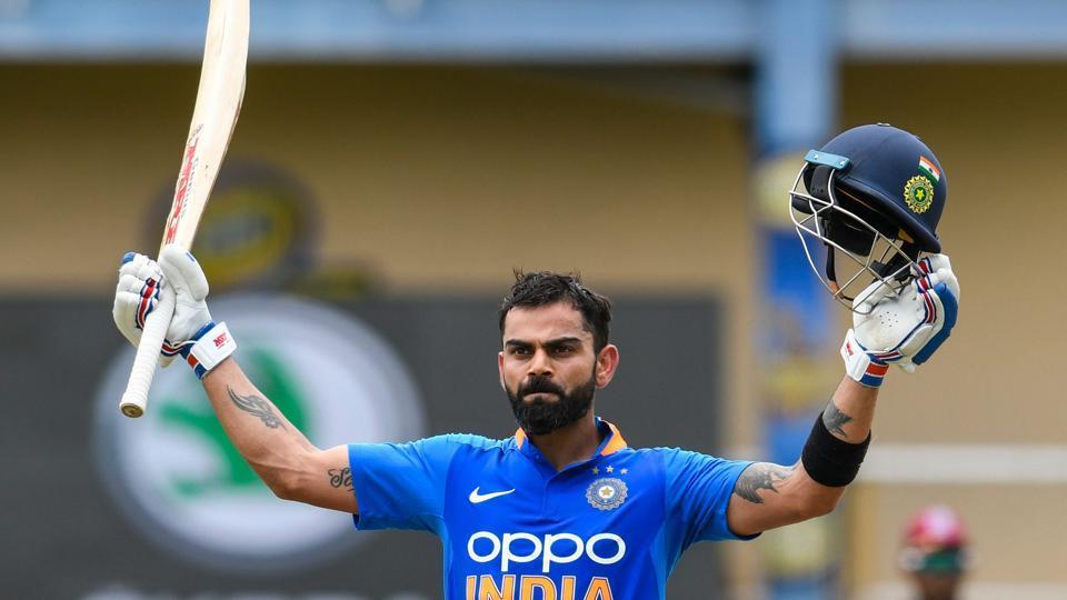 Virat Kohli of India celebrates his century.