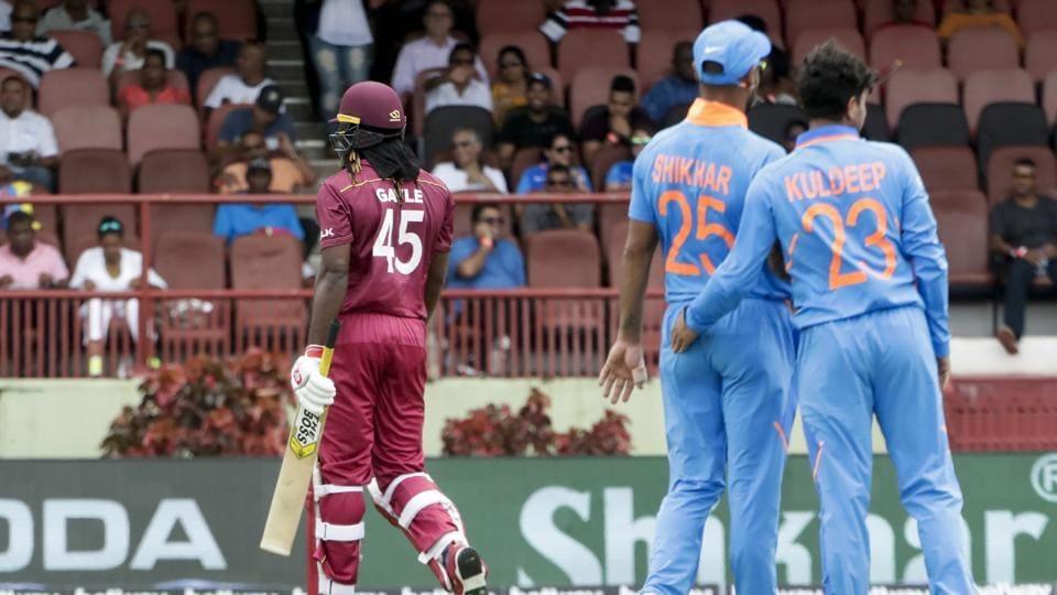 India's bowler Kuldeep Yadav, right and Shikhar Dhawan