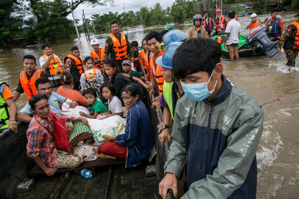 Rescuers evacuate residents by boat . Floodwaters have submerged more than 4,000 houses in the state and displaced more than 25,000 residents who have sought shelter in monasteries and pagodas, according to state-owned Global New Light of Myanmar.  (Sai Aung Main / AFP)