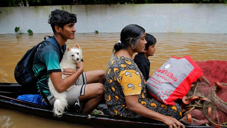 A flood-affected boy carries his dog as he and others are moved to a safer place in Paravur in Ernakulam district in the southern state of Kerala. The army, air force and the NDRF had launched massive relief and rescue operation in Kerala after incessant heavy rain had deluged the state. (Sivaram V / REUTERS)