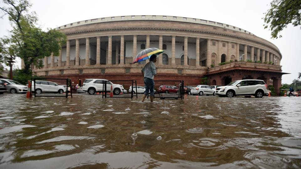 Water logging after rain seen at Parliament House premises, in New Delhi.  (Sonu Mehta / HT Photo)
