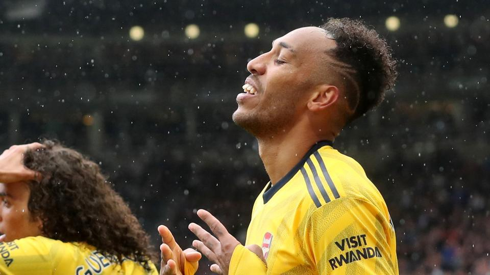 Arsenal's Pierre-Emerick Aubameyang celebrates scoring their first goal.