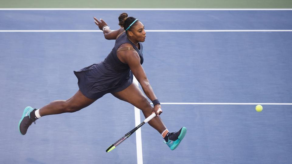 Serena Williams, of the United States, runs down a shot from Marie Bouzkova, of the Czech Republic.