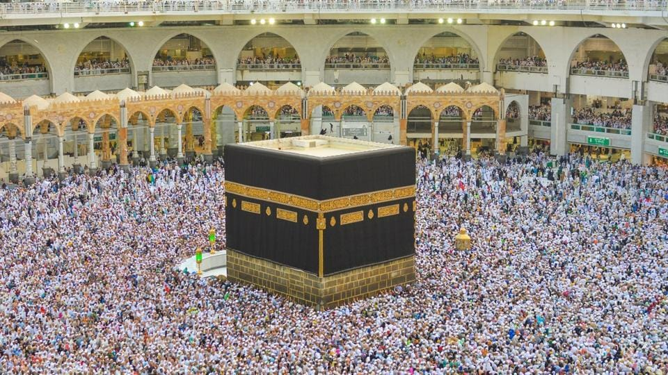 The Kaaba is a cube structure that is the focal point of Islam, draped in a gold-embroidered black cloth, towards which Muslims around the world pray.