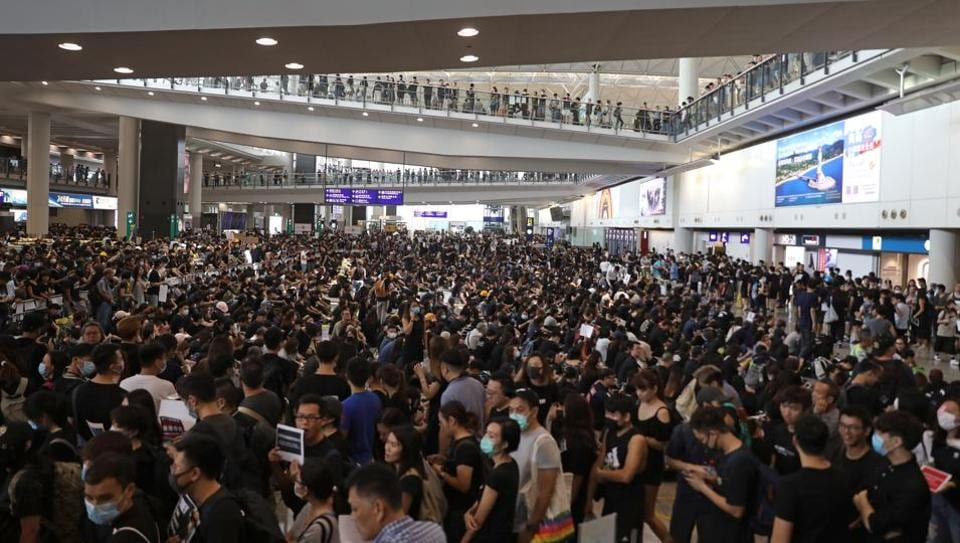 Demonstrators gather during a protest at the Hong Kong International Airport in Hong Kong, China, on Monday, August 12, 2019.