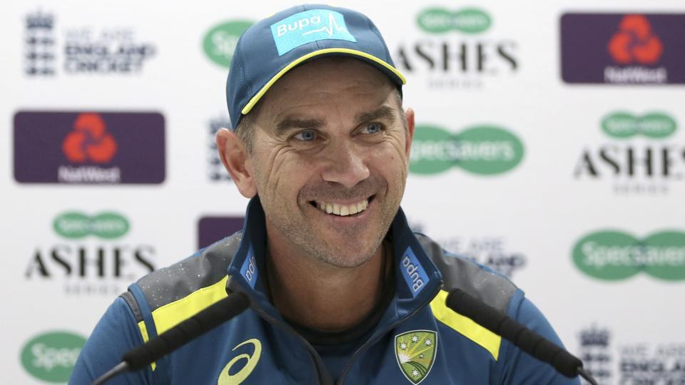Australia head coach Justin Langer smiles during a press conference.