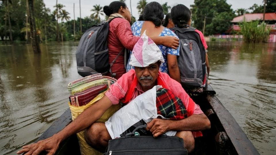 Flood-affected people are moved to a safer place at Paravur in Ernakulam district. The Indian Meteorological Department (IMD) has issued a red alert for Kannur, Kasaragod and Wayanad in view of heavy rain forecast. (Sivaram V / REUTERS)