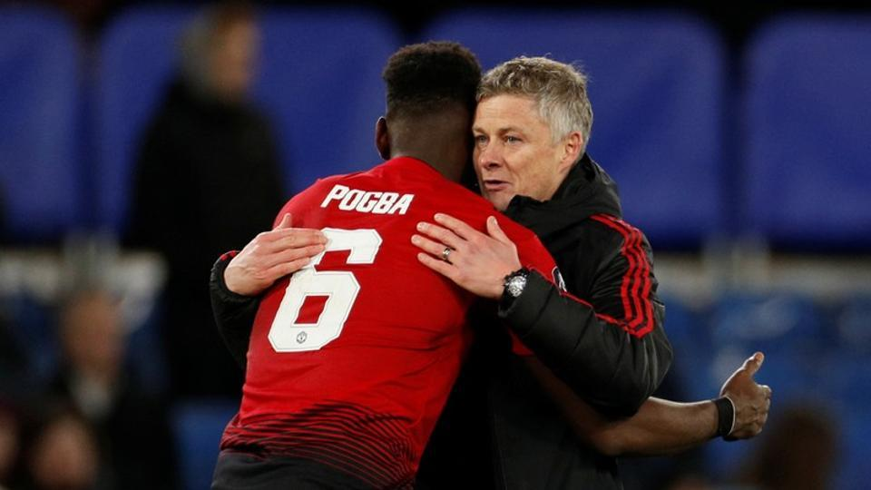 Manchester United manager Ole Gunnar Solskjaer embraces Paul Pogba.