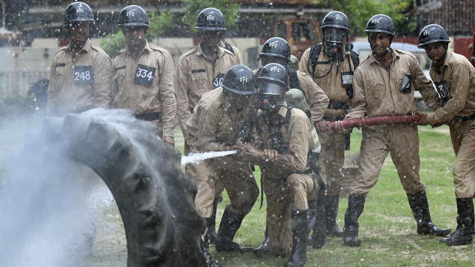 Cadets use water to douse fire during a drill. Fires kill around 80 people in the city every year. To ably combat these fires, the role of the firemen cannot be understated. (Raj K Raj / HT Photo)