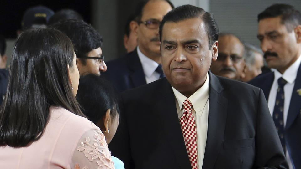 Chairman of Reliance Industries Limited Mukesh Ambani, center, arrives for the Annual General Meeting of Reliance Industries Limited in Mumbai.