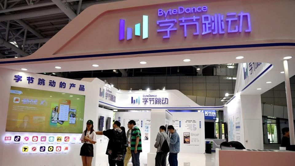 People are seen at the Bytedance Technology booth at the Digital China exhibition in Fuzhou, Fujian province, China May 5, 2019. REUTERS/Stringer/Files