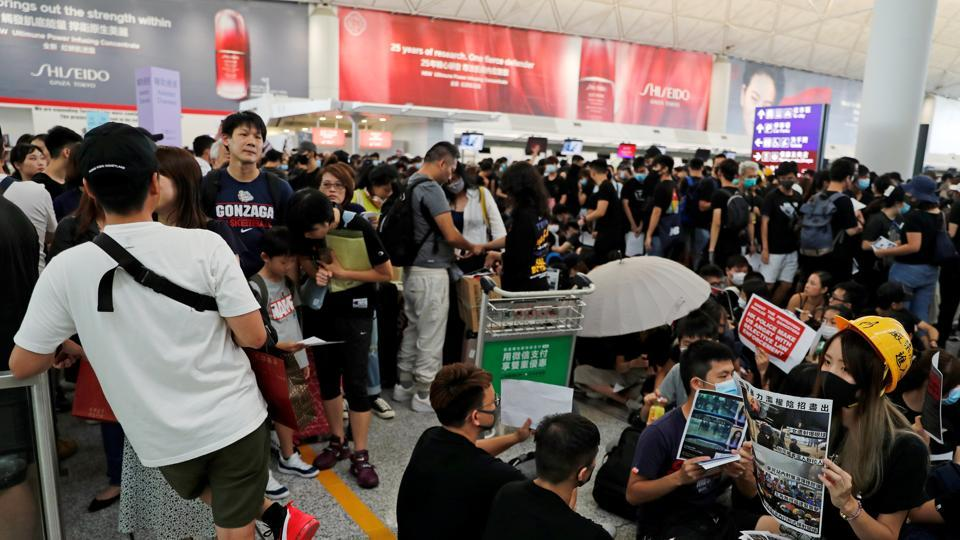 Anti-extradition bill protesters attend a mass demonstration after a woman was shot in the eye during a protest at Hong Kong International Airport, in Hong Kong, China August 12, 2019.