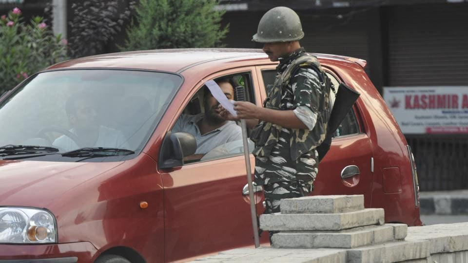 Paramilatary soldiers check documents during curfew on Eid al-Adha, at Down Town area, in Srinagar, Jammu and Kashmir, on Monday. (Photo by Waseem Andrabi / HT Photo)