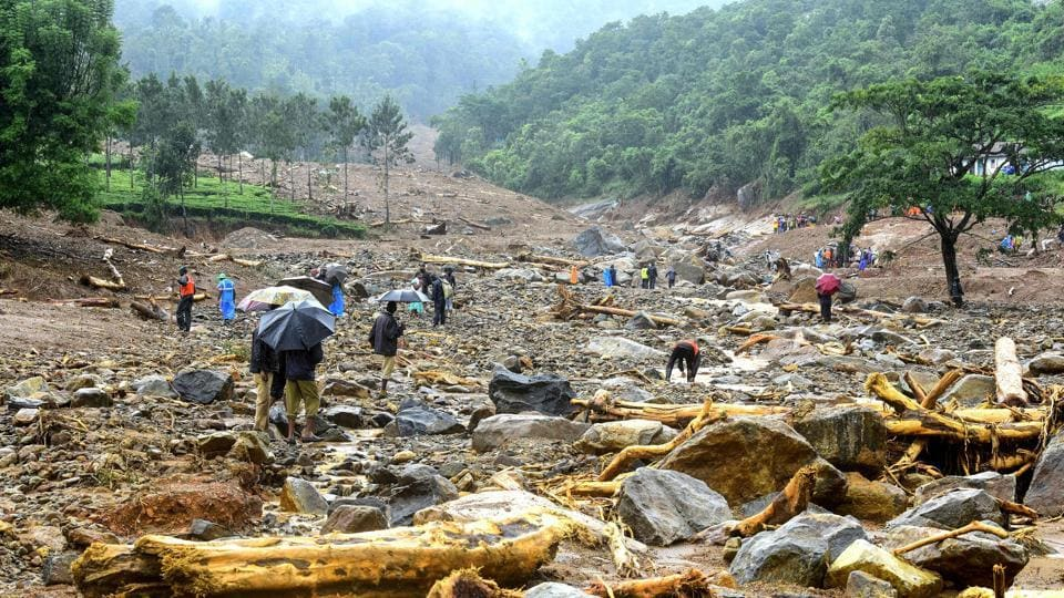 Volunteers, local residents and members of National Disaster Response Force (NDRF) search for survivors in the debris left by a landslide at Puthumala at Meppadi in the Wayanad district of the Indian state of Kerala on Saturday. (AFP)
