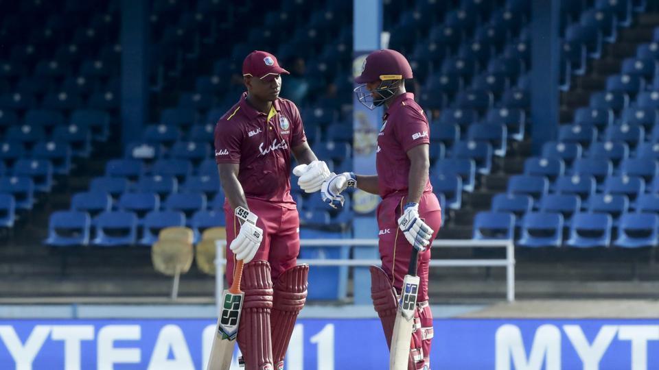 West Indies Evin Lewis, left, knocks his glove with batting partner Nicholas Pooran