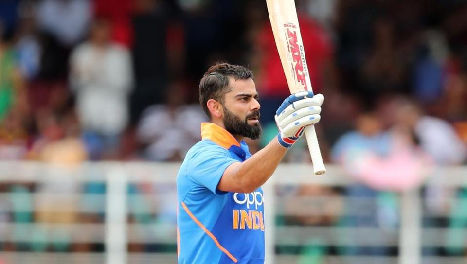 PORT OF SPAIN, TRINIDAD AND TOBAGO - AUGUST 11: Virat Kohli of India celebrates his century during the second ODI between the West Indies and India.