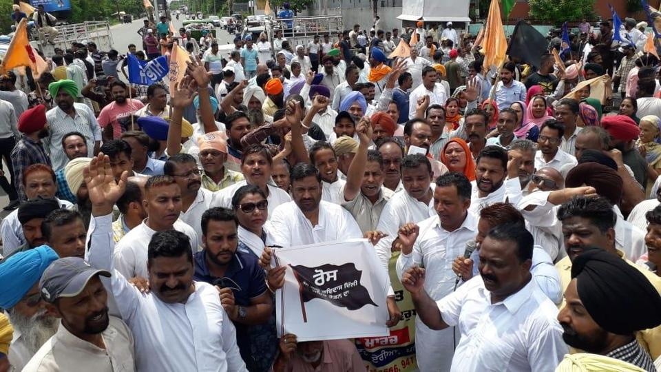 Membets of Ravidass community protest at bus stand chowk in Patiala.