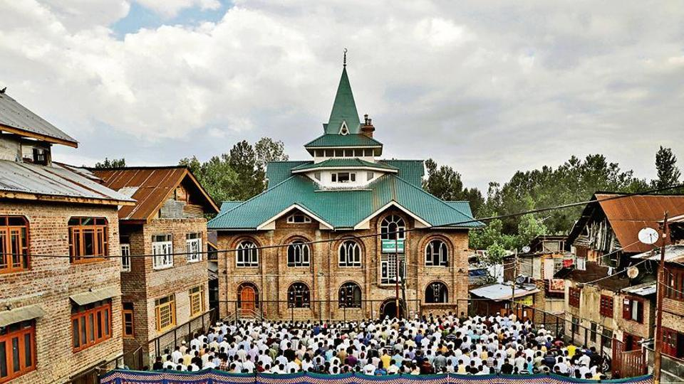 Kashmiris attend Eid-al-Adha prayers at a mosque during restrictions after the scrapping of the special constitutional status for Kashmir by the Indian government, in Srinagar on Monday.